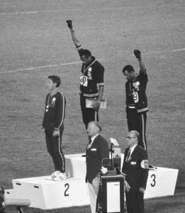 Sprinters Tommie Smith, John Carlos, and Peter Norman at award ceremony, Olympic games, 1968. Photo by Angelo Cozzi, public domain.